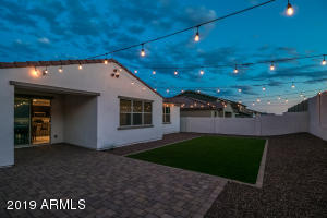 Picture yourself enjoying this tranquil backyard with high quality artificial turf! And string lights stay!!!