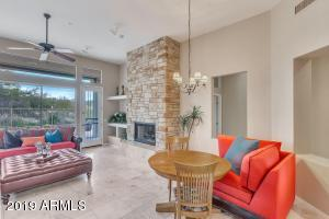 Elegant dining room/great room combination with voluminous views to backyard patio and desert preserve beyond
