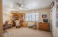 The very spacious 2nd Bedroom with white plantation shutters...