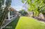 Beautiful and spacious backyard with artificial maintenance free grass!