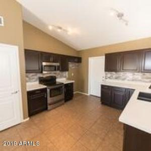 Stainless stove and microwave, great backsplash