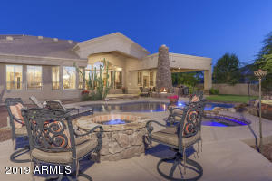 Cozy fire pit included in this entertainer's backyard ~ Yes, this is the life you've dreamed about!