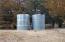 2 5000 gallon water storage tanks