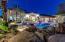 Evening view, partial, of backyard showcasing night lighting, pool and lagoon lighting.