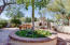 Front courtyard entry is expansive and inviting with kiva fireplace, banco seating, professionally landscaped with lighting and irrigation.