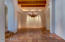 All areas of home has detailed lighting, including dining room with recessed, reflective lighting. This copper custom prickly pear chandelier stays with home. Dining room is located within easy steps of kitchen.
