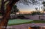 Putting green by SW Greens, SW portion of backyard with new night lighting, lagoon, fire rings and sunset views.
