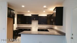 The kitchen layout but has white cabinets