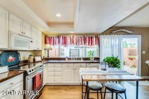 Bright open kitchen with view & sliding door to charming patio