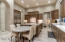 Kitchen with extended granite top for meals and entertaining.
