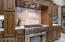 Awesome Thermador gas cooktop with oven and additional wall oven.
