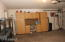 Garage with cabinets & water softner