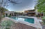 Home and a guest house with yard and pool