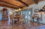 Dining room with wood ceilings and door to covered patio & pool