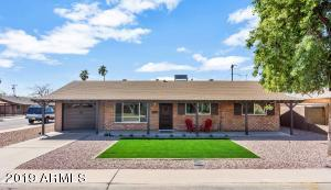 Truly one of the nicest remodels you will ever see in this price point. Spectacular mid-century modern home that is dripping with quality in a super south scottsdale location just minutes from Old Town Scottsdale. All new faux wood floors, kitchen is to die for with the extremely popular white cabinetry, faux marble (quartz) counter-tops which is all the current rage and stainless steel appliances., island which has grey cabinets & counter-tops to give it that designer look. Bathrooms are stunning with Porcelain tile, stone with dramatic fixtures. All new window package, new ductwork, new R-35 insulation & high end ceiling fans. Large laundry room with sink and extended 1 car garage. New landscaping front & back, 200 amp electrical service & backyard with covered patio and orange tree