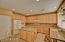 Spacious kitchen with gas range, double ovens, pantry and large center island.