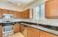 Maple cabinets, slab granite counters and stainless appliances