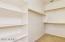 Huge walk in closet in master bedroom