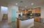 Kitchen is upgraded with staggered cinnamon stained maple cabinetry, granite countertops and stainless steel appliances.