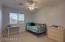 Large bedroom here with mirrored closet door, ceiling fan and raised panel door.