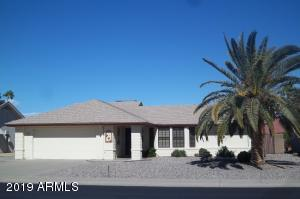 Front of House with beautiful Palm Tree