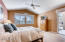 Master bedroom with doors to covered patio and golf course beyond