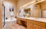 Master bathroom with spa tub, shower and separate toilet room