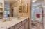 Separate vanity and towel storage area!