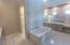 Heated Marble Floors, Rainshower head + 3 more, corner bench in shower too!