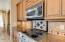 Stainless appliances with designer backsplash
