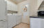 Spacious laundry room, lots of cabinet storage plus room for 2nd Fridge or Freezer