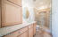 3/4 bath in casita offers lots of storage and has its own water heater.