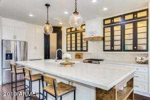 custom cabinets, quartz counters, custom ceiling/mouldings
