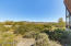 This property is surveyed. One acre has a private well so can be split to build a home, sell or keep as a rare 2.5 acre property in the heart of Desert Hills!
