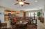 Tile floors, plantation shutters, ceiling fans.