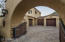 This gated motorcourt leads to a single and three car garage. The garages have epoxy flooring and high end custom cabinetry.