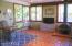 Fireplace, yard access and wonderful windows