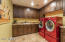 LARGE LAUNDRY ROOM. GRANITE COUNTERS, SINK, CUSTOM CABINETS
