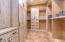 MASTER SUITE 2 WALK-IN CLOSETS WITH CUSTOM SHELVING. TRAVERTINE TILE