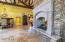 FRONT GREAT ROOM. GRAND SHOWCASE PASS-THRU FIREPLACE. STACKED STONE. SOARING CEILINGS