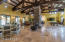 GREAT ROOM WITH SOARING CEILINGS. BEAMS IMPORTED FROM MOUNT ORD. TRAVERTINE TILE
