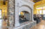 GRAND SHOWCASE AT FRONT ENTRANCE IN GREAT ROOM. PASS-THRU FIREPLACE W/ STACKED STONE. SOARING CEILINGS