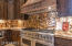 PROFESSIONAL DOUBLE VIKING GAS STOVE/OVENS. GRANITE BACKSPLASH AND COUNTERS. COPPER HOOD