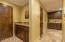 ENTRANCE FROM THE GARAGE TO KITCHEN. LAUNDRY ROOM, AND PANTRY. GRANITE COUNTERS. TRAVERTINE TILE.