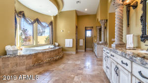 MASTER BATHROOM. GRANITE COUNTERS. TRAVERTINE FLOORING. JETTED TUB