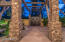 GRAND ENTRANCE GATED COURTYARD. ESTATE LUXURY. STACKED STONE COLUMNS