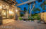 BEAUTIFUL COURTYARD WITH KOI POND, PAVERS, STACKED STONE COLUMNS. GRAND ENTRANCE.