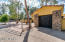 1 of 3 GARAGES. STACKED STONE COLUMNS.