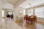 Coffered ceilings in formal dining room & room can easily accommodate a large table