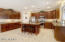 Spacious kitchen features upgraded cherry cabinets, granite counter tops, stainless steel appliances, and